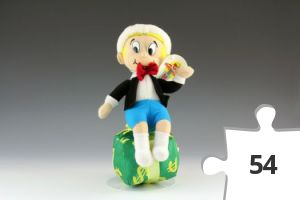 Jigsaw puzzle - Richie Rich 'Happy Houday!' doll