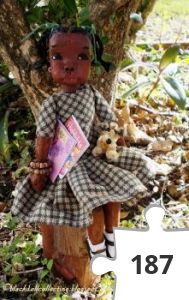 Jigsaw puzzle - Black Doll Collecting: Meet Kizzy, She is Sitting Under A Tree With Her Toys And Books,  By Kor January